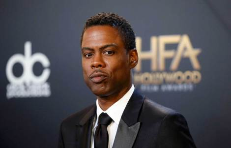 Chris Rock poses with his award during the Hollywood Film Awards in Hollywood