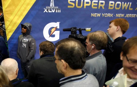 Seattle Seahawks running back Marshawn Lynch keeps a low profile during Media Day for Super Bowl XLVIII at the Prudential Center in Newark